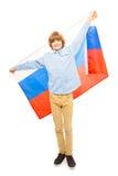 Teenager in wellenartig bewegender russischer Flagge der vollen Höhe Stockfotografie