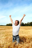 Teenager in wheat field Royalty Free Stock Photography
