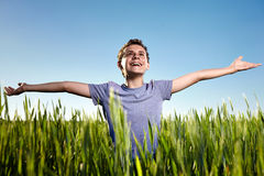 Teenager in a wheat field Royalty Free Stock Photography