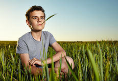 Teenager in a wheat field Stock Photos