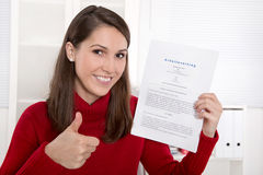 Teenager which his first contract for an job - german text Stock Image