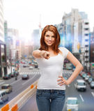 Teenager in white t-shirt pointing at you. Gestures, tourism, vacation and people concept - happy teenager in white t-shirt pointing at you Stock Photos