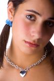 Teenager whith necklace. Teenager in white background royalty free stock photos