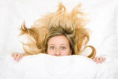 Teenager with wild hair in bed Stock Photos