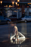 Teenager Through Window in Pizza Place Royalty Free Stock Images