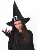 Teenager Witch. A teenager witch with red claws royalty free stock image