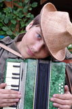 Teenager With Hat Accordion Player Outdoors Royalty Free Stock Image