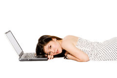 Teenager witha resting on laptop. Young teenager with a beautiful smile and her laptop computer Royalty Free Stock Images