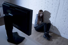 Teenager woman abused suffering internet cyberbullying scared sad depressed in fear face expression Stock Photos
