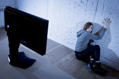 Teenager woman abused suffering internet cyberbullying scared sad depressed in fear face expression Stock Photo