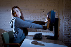 Teenager woman abused suffering internet cyberbullying scared sad depressed in fear face expression Royalty Free Stock Photo