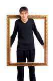Teenager in the Wooden Frame Royalty Free Stock Images