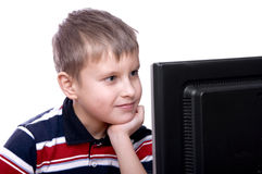 Teenager working on computer. Portrait of a smiling young teenager working on computer isolated Stock Image