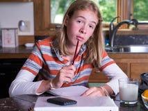 Teenager working on homework Stock Photos