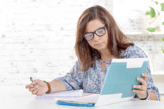 A teenager working homework Royalty Free Stock Photo