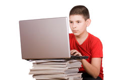 Teenager working on notebook Stock Images