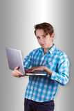 Teenager is working or playing in laptop. Stock Image