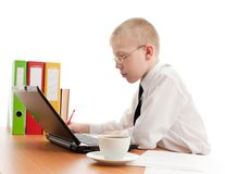 Teenager working in usual office space Stock Photography