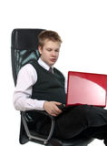 The teenager works on the computer Royalty Free Stock Photos