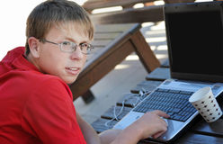 Teenager works for the computer Stock Images