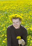 Teenager in wreath of dandelions Stock Image