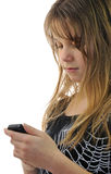 Teenager writing sms. Pretty teen girl writing message on mobile Stock Photos
