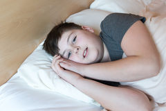 Teenager of 13 years lying in bed Royalty Free Stock Photo