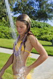 Teenager in yellow bikini taking a shower Royalty Free Stock Photo