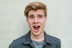 Teenager young man portrait model excited surprise Stock Photos
