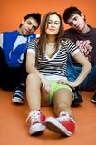 Teenagers. 3 teenagers sitting on the ground royalty free stock photo
