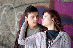 Teenagers. Couple in front of graffiti wall Stock Images