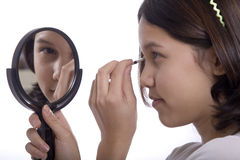 Teenagers applying makeup Royalty Free Stock Image