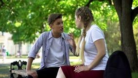 Teenagers arguing in park, break up because of misunderstanding, conflict. Stock photo stock photos