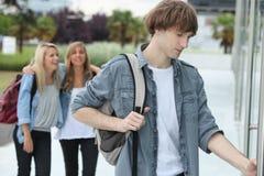 Teenagers arriving at college. Three teenagers arriving at college royalty free stock photos