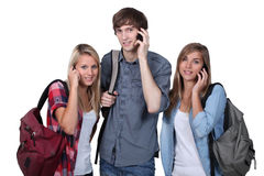 Teenagers with backpacks. And mobile Royalty Free Stock Image