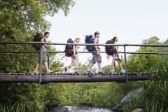 Teenagers With Backpacks Walking On Bridge Stock Image