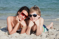 Teenagers at the Beach. Teenagers lying on the sand in Miami Beach royalty free stock photography