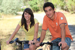 Teenagers on a bike ride Stock Images