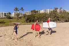 Teenagers Boards Beach Stock Photos