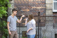 Teenagers, boy and girl talking on the street. Nappy. Stock Photo