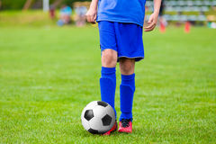 Teenagers Boys Playing Soccer Football Match. Young Football Player. S Running and Kicking Soccer Ball on a Soccer Pitch. Youth soccer league stock photo