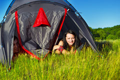 Teenagers in a camping tent Stock Photos