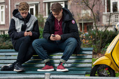 Teenagers with cellphones Royalty Free Stock Image