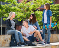 Teenagers chatting outdoors in town Stock Image