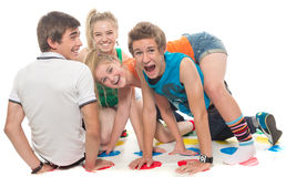 Teenagers cheerfully play Royalty Free Stock Photo