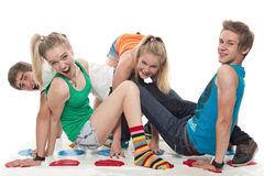 Teenagers cheerfully play Royalty Free Stock Image
