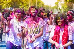 Teenagers and children having fun with colored water and holi powder during the Hindu festival of colors, Dhaka, Bangladesh. royalty free stock images