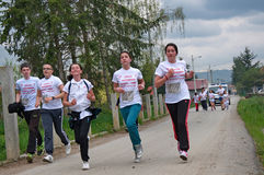 Teenagers and children run a marathon race royalty free stock images