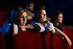Teenagers at the cinema Stock Photography