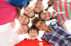 Teenagers in circle. Close together smiling stock photos